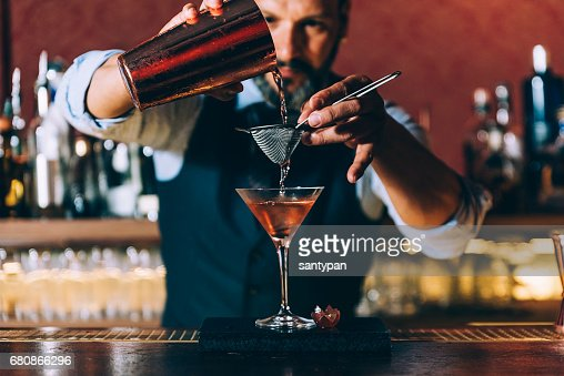Barman is making cocktail at night club. : Stock Photo