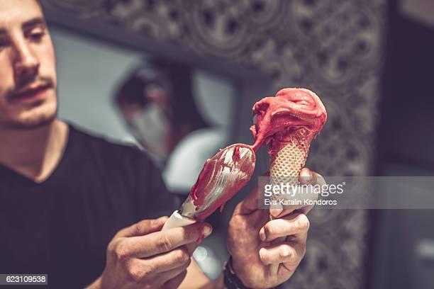 Barman is serving ice cream