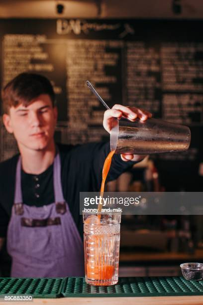 Barman making a cocktail