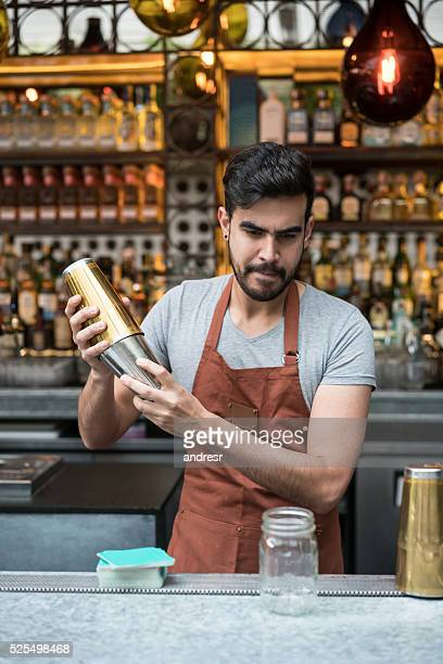 Barman making cocktails at a bar