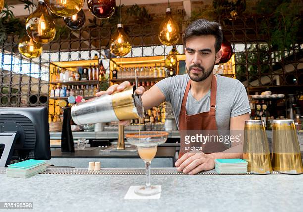 Barman making cocktails at the bar