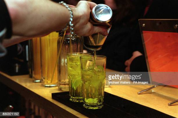 A barman pouring drinks in Fluid bar 40 Charterhouse Street in Clerkenwell London 05/11/02 Half of men and a quarter of women in the North consume...