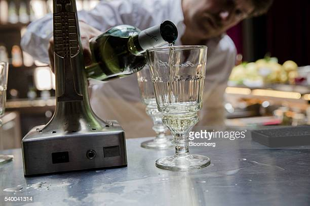 A barman pours a pontarlier glass of absinthe in the bar area at Pernod Ricard SA's absinthe distillery in Thuir France on Tuesday June 7 2016 The...