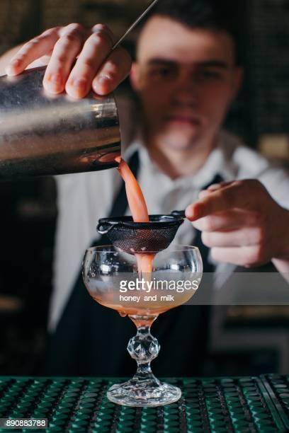 Barman preparing a cocktail