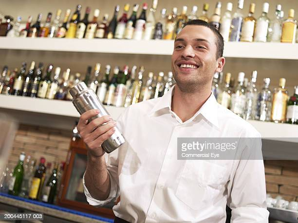 Barman shaking cocktail
