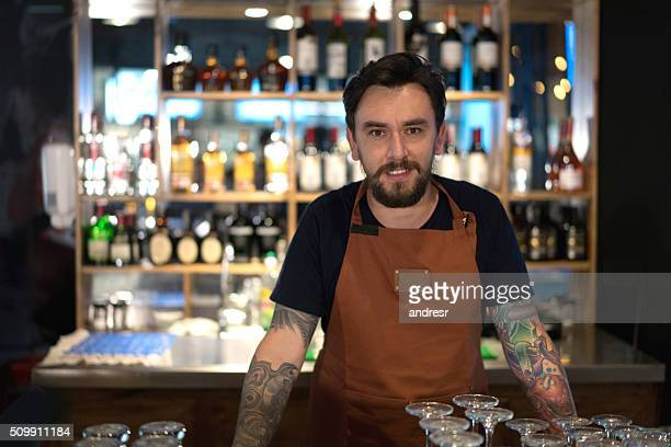 Barman working at the bar counter
