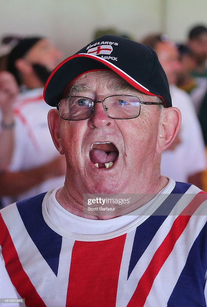 A Barmy Army member sings during day one of the First Ashes Test match between Australia and England at The Gabba on November 21, 2013 in Brisbane, Australia. The Barmy Army is a group of English cricket fans which arranges touring parties for some of its members to support the English cricket team on overseas tours, as well as followers of the team who join in with match day activities in the crowd, but do not travel as part of an organised tour.