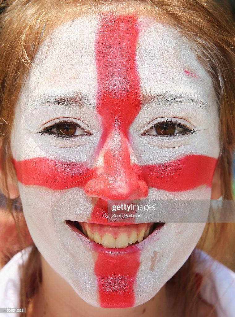 A Barmy Army member with facepaint poses during day one of the First Ashes Test match between Australia and England at The Gabba on November 21, 2013 in Brisbane, Australia. The Barmy Army is a group of English cricket fans which arranges touring parties for some of its members to support the English cricket team on overseas tours, as well as followers of the team who join in with match day activities in the crowd, but do not travel as part of an organised tour.
