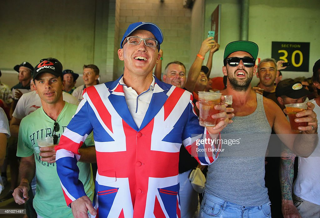 Barmy Army members drink beer during day one of the First Ashes Test match between Australia and England at The Gabba on November 21, 2013 in Brisbane, Australia. The Barmy Army is a group of English cricket fans which arranges touring parties for some of its members to support the English cricket team on overseas tours, as well as followers of the team who join in with match day activities in the crowd, but do not travel as part of an organised tour.