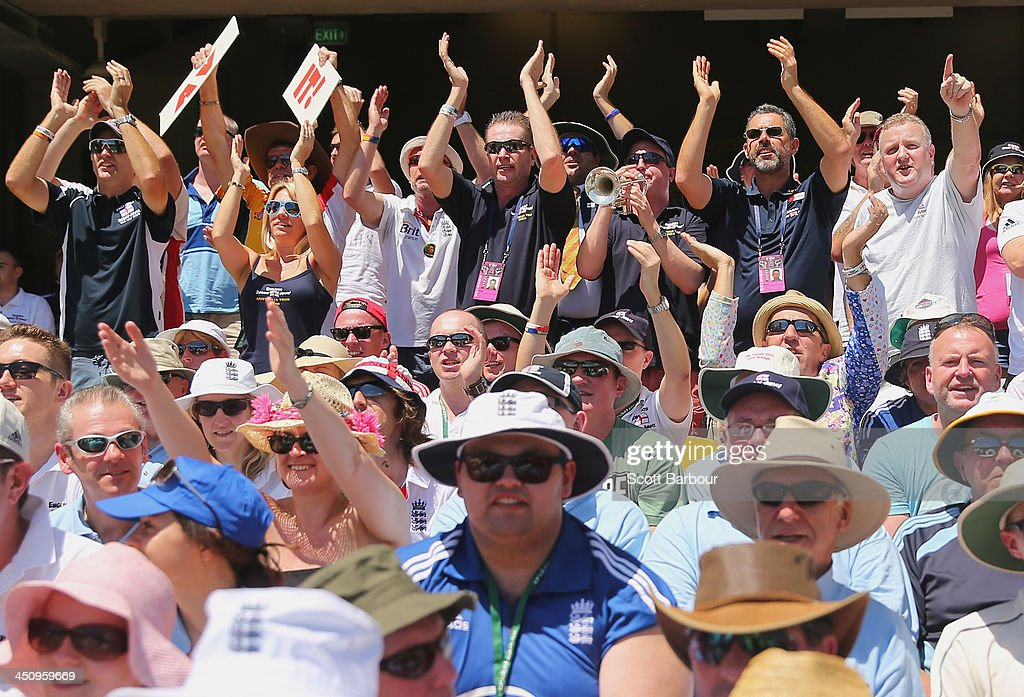 Barmy Army members show their support during day one of the First Ashes Test match between Australia and England at The Gabba on November 21, 2013 in Brisbane, Australia. The Barmy Army is a group of English cricket fans which arranges touring parties for some of its members to support the English cricket team on overseas tours, as well as followers of the team who join in with match day activities in the crowd, but do not travel as part of an organised tour.