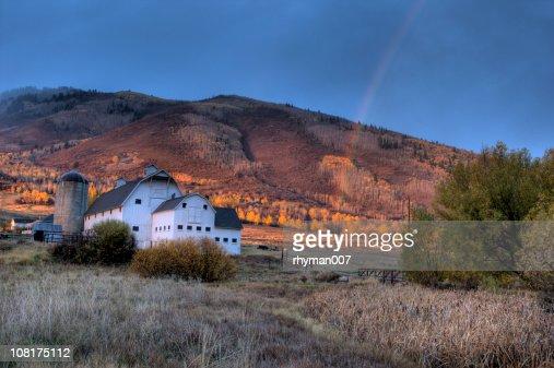 Barn and Rainbow : Stock Photo