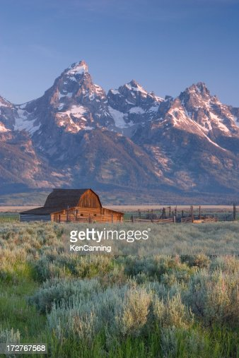 Barn and snow covered mountains in the American west
