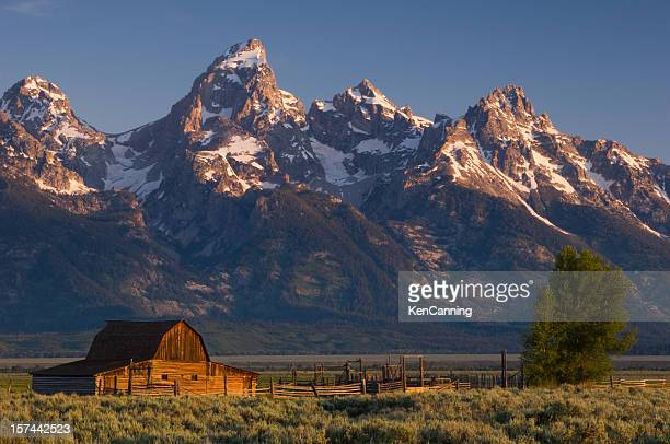 Barn and snow covered Teton mountain range