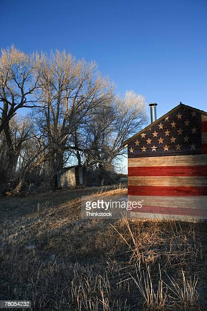 Barn with American flag painted on it