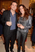 Barnaby Thompson and Christina Robert attends the Mulberry dinner to celebrate the launch of the Cara Delevingne Collection at Claridge's Hotel on...