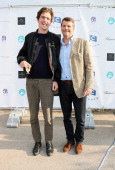 Barnaby Thompson and guest attend the Chucs Swimathon hosted by Charles Finch at the Serpentine Hyde Park on July 4 2013 in London England