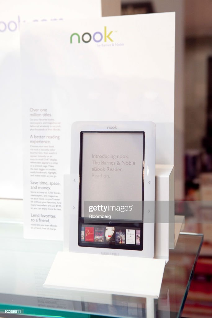 Barnes & Noble Inc.'s new electronic-book reader called the The Nook sits on display at a news conference in New York, U.S., on Tuesday, Oct. 20, 2009. Barnes & Noble Inc., the largest U.S. bookstore chain, is entering a market dominated by Amazon.com Inc. and Sony Corp. Photographer: JB Reed/Bloomberg
