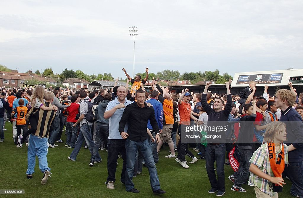 Barnet fans celebrate after their team's victory ensures their league survival in the npower League Two match between Barnet and Port Vale at Underhill Stadium on May 7, 2011 in Barnet, England.