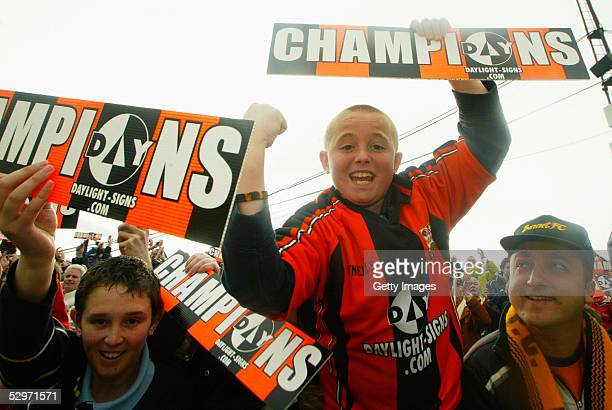Barnet fans celebrate following the Nationwide Conference match between Barnet and Halifax Town at the Underhill Stadium on April 9 2005 in Barnet...