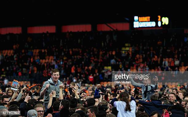 Barnet fans invade the pitch after the final whistle as their team win promotion during the Vanarama Football Conference League match between Barnet...