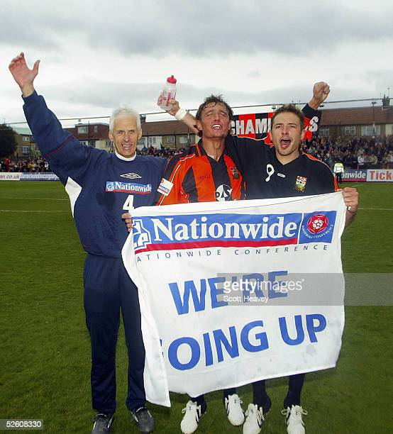 Barnet manager Paul Fairclough with Captain Ian Hendon and match winner Giuliano Grazioli celebrate winning the Nationwide Conference and promotion...