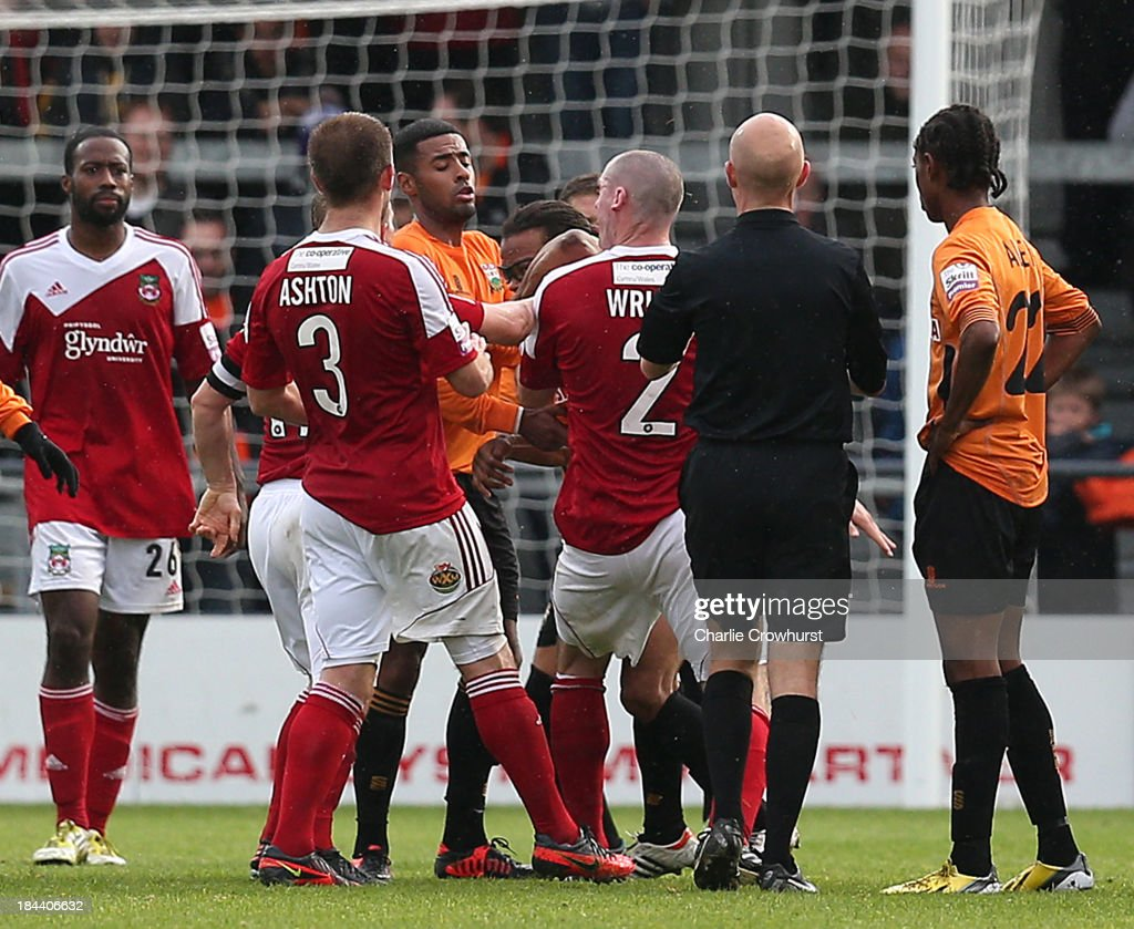 Barnet player manager <a gi-track='captionPersonalityLinkClicked' href=/galleries/search?phrase=Edgar+Davids&family=editorial&specificpeople=213130 ng-click='$event.stopPropagation()'>Edgar Davids</a> (C) elbows <a gi-track='captionPersonalityLinkClicked' href=/galleries/search?phrase=Stephen+Wright+-+Soccer+Player&family=editorial&specificpeople=4778805 ng-click='$event.stopPropagation()'>Stephen Wright</a> #2 of Wrexham in the face, watched by referee Nick Kinseley during the Skrill Conference Premier match between Barnet and Wrexham AFC at The Hive Stadium on October 13, 2013 in London, England.