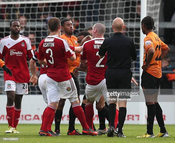 Barnet player manager Edgar Davids elbows Stephen Wright of Wrexham in the face watched by referee Nick Kinseley during the Skrill Conference Premier...