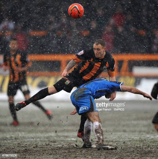 Barnet's Barry Fuller and Cheltenham's Sam Deering battle for the ball