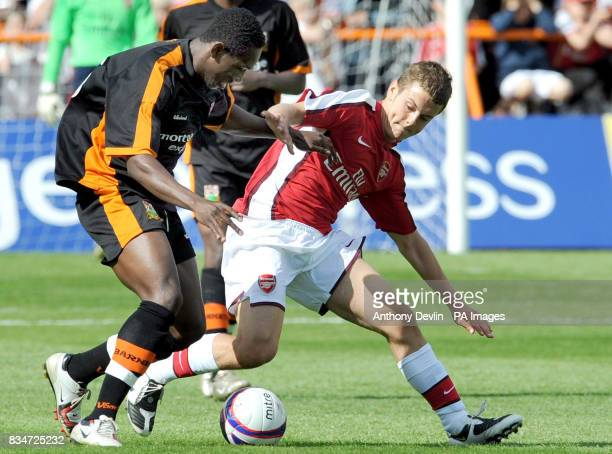 Barnet's Ismail Yakubu and Arsenal's Jack Wilshere battle for the ball during the preseason friendly match at Underhill Stadium in Barnet
