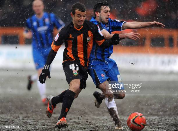 Barnet's Kyle De Silva and Cheltenham's Sam Deering battle for the ball
