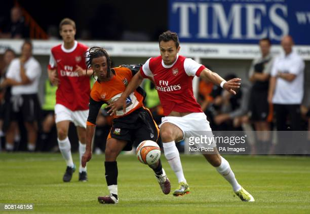 Barnet's Sam Cox and Arsenal's Nacer Barazite battle for the ball