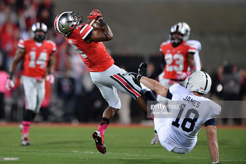C.J. Barnett #4 of the Ohio State Buckeyes intercepts a pass intended for <a gi-track='captionPersonalityLinkClicked' href=/galleries/search?phrase=Jesse+James+-+American+Football+Player&family=editorial&specificpeople=15268672 ng-click='$event.stopPropagation()'>Jesse James</a> #18 of the Penn State Nittany Lions in the first quarter at Ohio Stadium on October 26, 2013 in Columbus, Ohio.