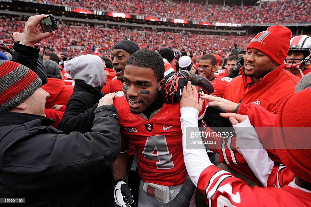 C.J. Barnett #4 of the Ohio State Buckeyes is congratulated by fans after Ohio State defeated the Michigan Wolverines 26-21 at Ohio Stadium on November 24, 2012 in Columbus, Ohio.
