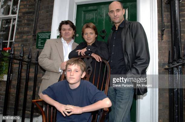 Barney Clark who plays Oliver with Jamie Foreman who plays Bill Sykes Harry Eden who plays the Artful Dodger and Mark Strong who plays Toby Crackit...