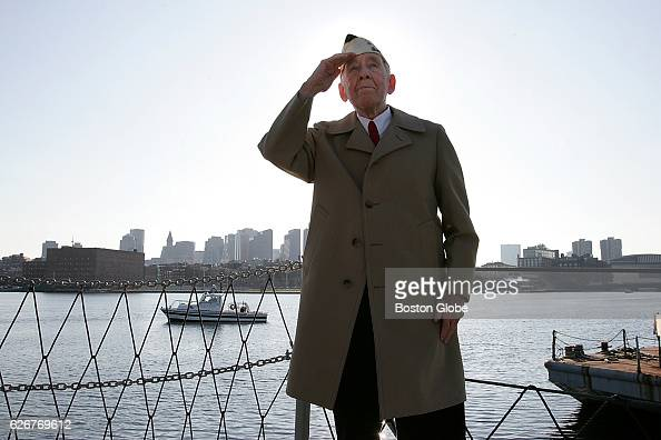 Barney Murphy salutes during the annual Pearl Harbor Survivors Association and Friends Memorial Service on the deck of the USS Cassin Young DD79 at...