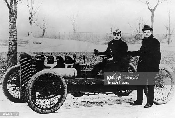 Barney Oldfield and Henry Ford with Ford '999' 1902 Oldfield is in the driving seat while Henry Ford stands alongside Ford drove the car on the ice...