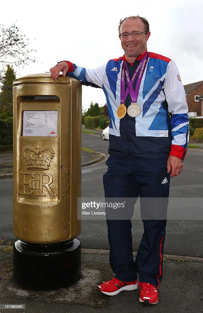 <a gi-track='captionPersonalityLinkClicked' href=/galleries/search?phrase=Barney+Storey&family=editorial&specificpeople=650752 ng-click='$event.stopPropagation()'>Barney Storey</a> poses with his Paralympic medals next to a gold painted Royal Mail post box in the village of Poynton on September 14, 2012 in Stockport, England.