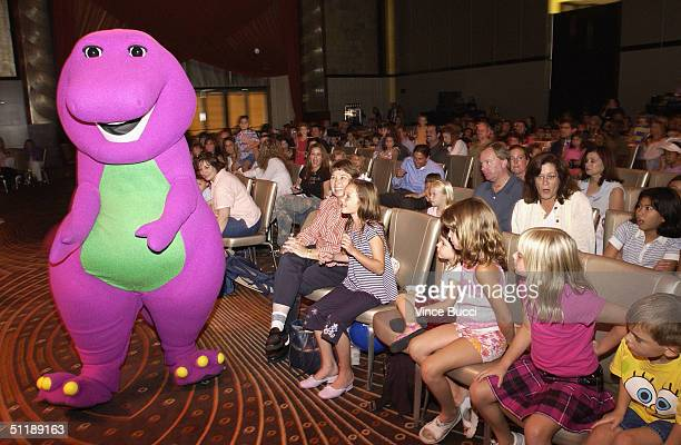 Barney the dinosaur greets the audience during the Hollywood Radio and Television Society's 10th Annual Kids Day 2004 show on August 18 2004 at...