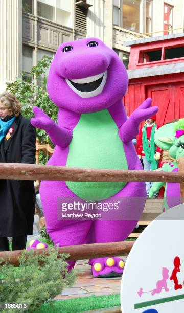 Barney the dinosaur rides on a float at the 76th Annual Macy's Thanksgiving Day Parade in Herald Square November 28 2002 in New York City