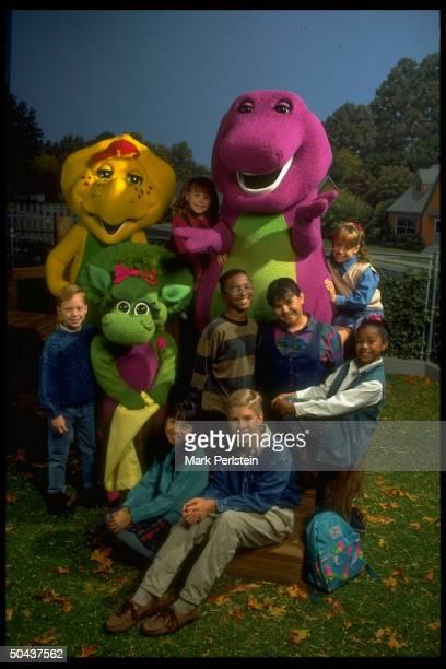 Barney the purple dinosaur dominating scene fr PBS TV series Barney Friends