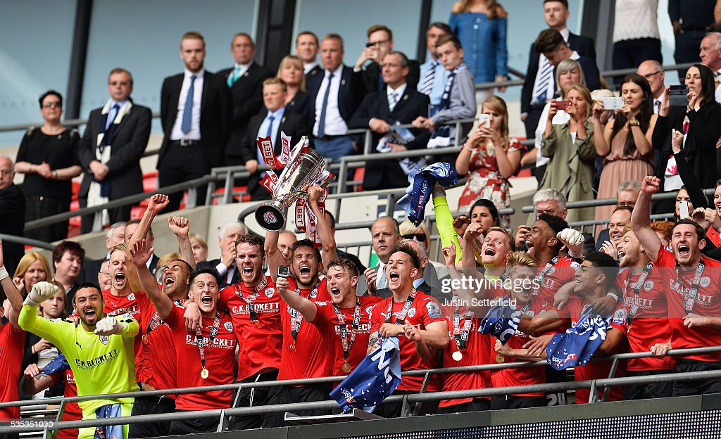 Barnsley celebrate winning the Sky Bet League One Play Off Final after beating Millwall at Wembley Stadium on May 29, 2016 in London, England.
