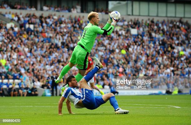 Barnsley goalkeeper Adam Davies and Brighton Hove Albion's Tomer Hemed battle for the ball during the Sky Bet Championship match at the AMEX Stadium...