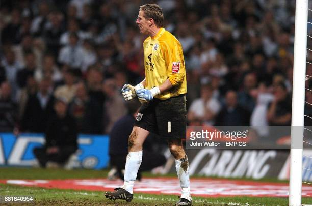 Barnsley goalkeeper Nick Colgan celebrates saving a penalty from Swansea City's Adebayo Akinfenwa