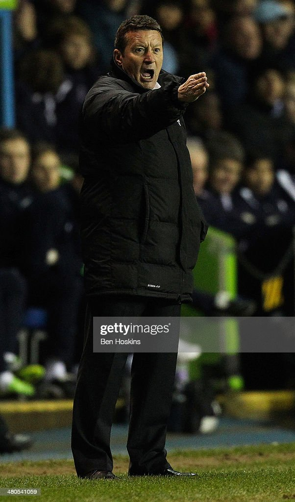 Barnsley manager Danny Wilson shouts instructions during the Sky Bet Championship match between Reading and Barnsley at Madejski Stadium on March 25, 2014 in Reading, England,