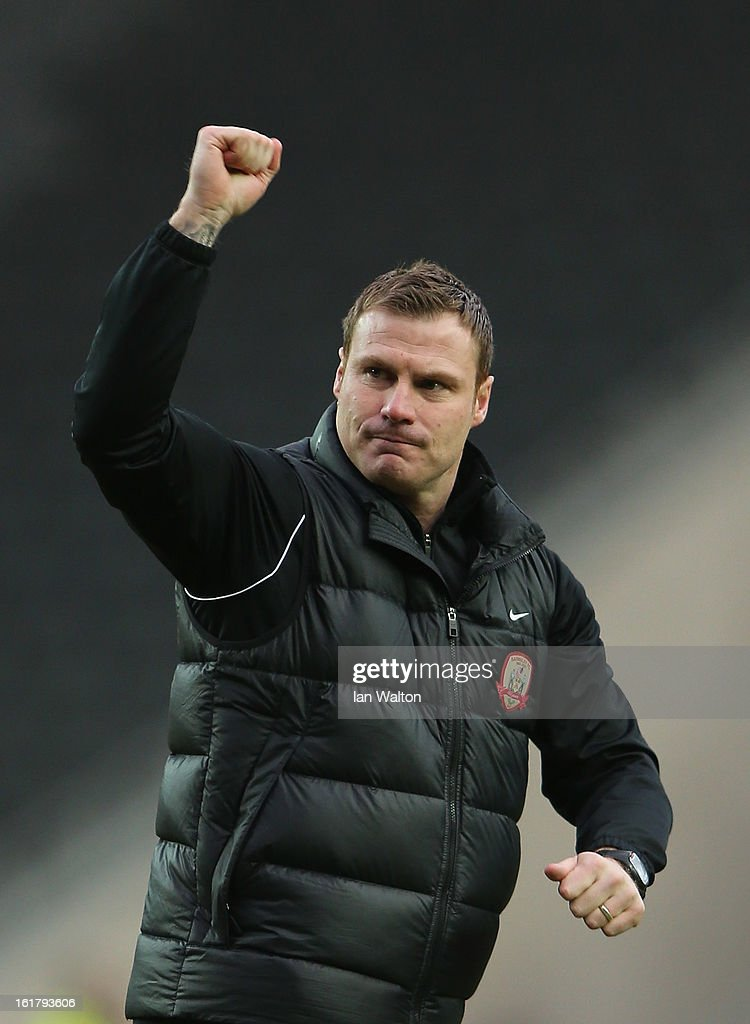 Barnsley manager David Flitcroft celebrates after he FA Cup Fifth Round match between MK Dons and Barnsley at StadiumMK on February 16, 2013 in Milton Keynes, England.