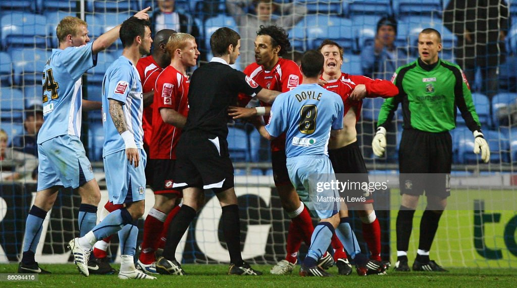 Barnsley players argue with referee Stephen Cook after a penalty decision during the CocaCola Championship match between Coventry City and Barnsley...