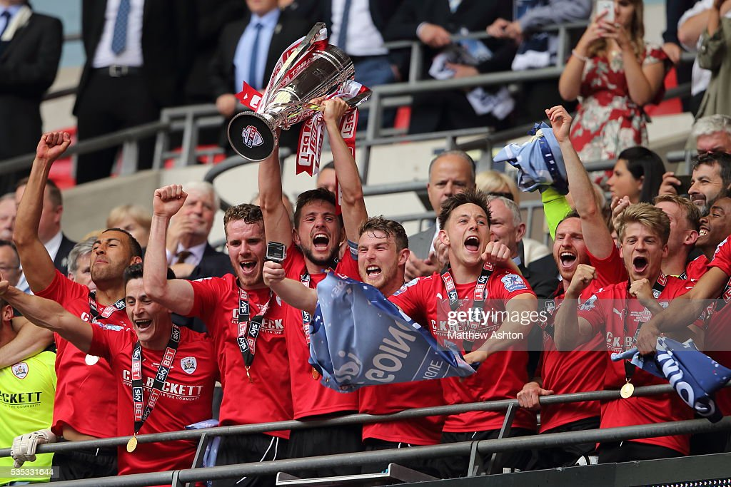 Barnsley players celebrate promotion after winning the Sky Bet League One Play Off Final between Barnsley and Millwall at Wembley Stadium on May 29, 2016 in London, England.