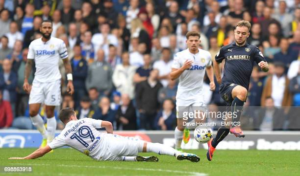 Barnsley's Adam Armstrong evades the tackle of Leeds United's Pablo Hernndez