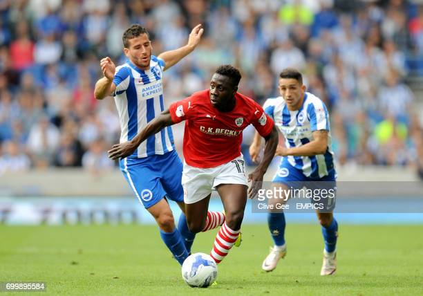 Barnsley's Andy Yiadom dribbles between Brighton Hove Albion's Tomer Hemed and Anthony Knockaert during the Sky Bet Championship match at the AMEX...
