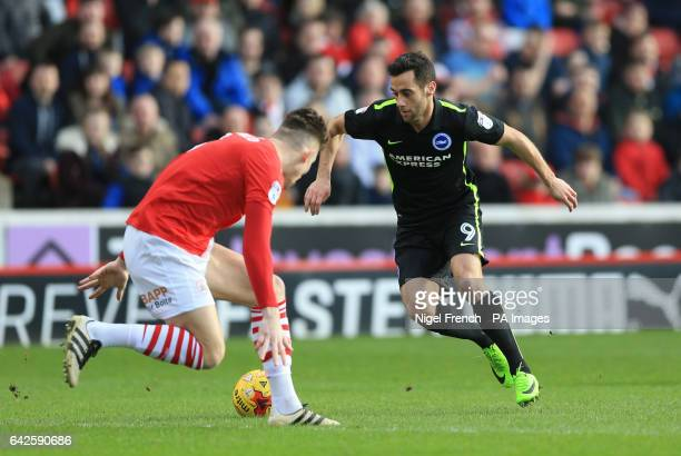 Barnsley's Angus MacDonald and Brighton Hove Albion's Sam Baldock battle for the ball during the Sky Bet Championship match at Oakwell Barnsley
